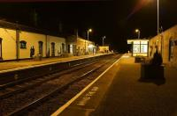 A quiet period at Market Rasen on the evening of 8 October 2013 looking north towards Barnetby. The station is well looked after by the�local adoption group with flower planters and lots of posters and photo collections of the station in former days.<br><br>[John McIntyre&nbsp;08/10/2013]