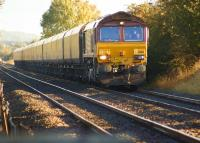 DBS 66183 hauls a rake of empty coal wagons north approaching Howsham on 9 October 2013 heading to Immingham.<br><br>[John McIntyre&nbsp;09/10/2013]