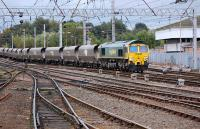 Freightliner 66551 passes Carlisle Signalling Centre on 1 October with the�4S28�Fiddlers Ferry - Hunterston empties.<br><br>[Bill Roberton&nbsp;11/10/2013]