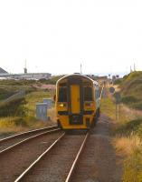 A southbound Cambrian Coast Line service approaching Tywyn station on a summer evening in August 2011, ultimate destination Birmingham International.<br><br>[Ian Dinmore&nbsp;17/08/2011]