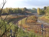 The start of the Borders Railway at the north end of Millerhill yard, seen looking south west over the junction in early morning autumn sunshine on 20 October 2013. Beyond the buffer stops at the end of the turnback siding trackbed preparations continue towards what will become Shawfair station. <br><br>[John Furnevel&nbsp;20/10/2013]