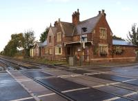 The former Moortown station buildings viewed north over the B1205 level crossing on 9 October 2013. The station opened in 1848 and closed in 1965.<br><br>[John McIntyre&nbsp;09/10/2013]