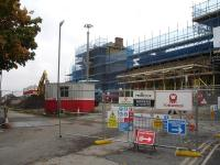 The scaffold encased east end frontage of Wakefield Kirkgate on 18 October during works which include a new ticket office, caf�, offices and other facilities. The canopy along the front of the original main entrance and ticket office has been stripped back to the base support framework. <br><br>[David Pesterfield&nbsp;18/10/2013]