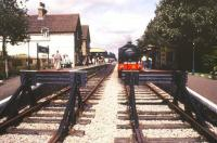 Looking over the buffer stops at Isfield on the Lavender Line in December 1988. Standing at the platform with a train is 0-6-0ST No 62 <I>Ugly</I> (RSH 7673 of 1950). <br><br>[Ian Dinmore&nbsp;/12/1988]