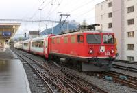 Built in 1947, and still in front line service, RhB Ge4/4 1 No. 603 <I>Badus</I> stands at Davos Platz waiting to move the westbound <I>Glacier Express</I> stock into the platform from its overnight stabling road before taking it out to Chur. The class of ten was modernised in 1986, and six have been scrapped in recent years, but its a testament to the survivors that they are still entrusted with a prestige service like this. Note the old style dining car in the rake of <I>Panoramique</I> stock [See image 45044]<br><br>[Mark Bartlett&nbsp;18/09/2013]