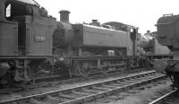 Tank engines in the yard at Cardiff Radyr shed in August 1962 include Collett 0-6-2T 6608 and Hawksworth 0-6-0PT 3400.<br><br>[K A Gray&nbsp;12/08/1962]
