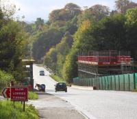 Entrance to the Borders Railway construction site on the A7 between Newtongrange and Gorebridge, with the new Gore Glen bridge taking shape beyond. View is south on Sunday 20 October 2013.  <br><br>[John Furnevel&nbsp;20/10/2013]