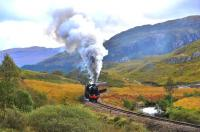 With two weeks to go until the end of the steam excursion season, autumn colours abound as Black 5 no 45407 <I>The Lancashire Fusilier</I> charges onward after a slow climb out of Glenfinnan Station with <I>The Jacobite</I> for Mallaig. <br><br>[John Gray&nbsp;21/10/2013]
