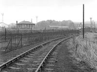Looking along the closed Riddochhill Colliery/British Leyland branch in 1984 with Bathgate Upper station in the background.<br><br>[Bill Roberton&nbsp;//1984]