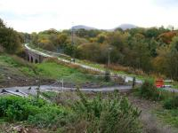 Looking south along the Black Path towards the Red Bridge at Galashiels on 24 October 2013. Beyond stands Tweedbank with the Eildon Hills on the horizon. Photographed from the temporary path recently put in place to bypass the bridge works on Winston Road [see image 42351] part of which is currently closed and inaccessible.<br><br>[John Furnevel&nbsp;24/10/2013]