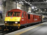 DB-liveried 90018 with the London sleeper at Waverley on the evening of 24 October. <br><br>[Bill Roberton&nbsp;24/10/2013]