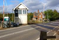 Looking north over the level crossing on the busy A46 road at Holton-le-Moor, Lincolnshire, on 9 October, with the former station building opposite. <br><br>[John McIntyre&nbsp;09/10/2013]