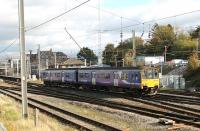 Crossing from the Barrow line platform to the Up Main line as it leaves Carnforth is Northern 150145. The train is the daily Leeds to Heysham Port service, which will reverse at Lancaster and Morecambe before connecting with the Douglas sailing. <br><br>[Mark Bartlett&nbsp;25/10/2013]