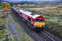 DB Schenker liveried Class 66 No.66101 at Tomatin on 26 October heading north with a heavily laden ballast train. <br><br>[John Gray&nbsp;26/10/2013]
