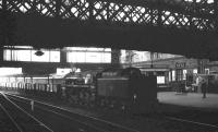 BR Standard class 9F 2-10-0 no 92021 brings a southbound ballast train through Carlisle station in August 1965. The locomotive was one of 10 examples of the class (92020 - 92029) originally built with Franco-Crosti boilers, prior to later conversion to the standard arrangement. <br><br>[K A Gray&nbsp;22/08/1965]