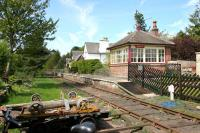 The station and signal box at Warcop, Cumbria, on the Eden Valley line, photographed looking north west on a fine afternoon in May 2006. The station closed to passengers in 1962 and the line back to Appleby in 1989. Warcop is now the headquarters of the Eden Valley Railway. [See image 32774]<br><br>[John Furnevel&nbsp;11/05/2006]