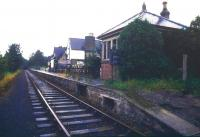 Looking north along the platform at a wet Warcop station in August 1988. [See image 32774]<br><br>[Ian Dinmore&nbsp;23/08/1988]