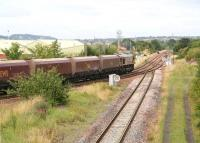 An unidentified EWS class 66 is about to take coal empties from the Millerhill direction onto the 'sub' at Niddrie West Junction in July 2011.<br><br>[John Furnevel&nbsp;29/07/2011]