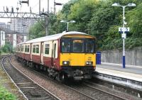 The Sunday 14.41 Balloch - Partick runs into platform 4 at Dalmuir station on 9 September 2012.<br><br>[John Furnevel&nbsp;09/09/2012]