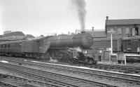 Gresley V2 2-6-2 no 60870 photographed at Doncaster station on 31 May 1963 with an up special from Leeds Central to Folkestone Harbour.<br><br>[K A Gray&nbsp;31/05/1963]