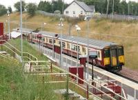 318261 calls at Merryton on 18 August 2006 with a Dalmuir - Larkhall service. <br><br>[John Furnevel&nbsp;18/08/2006]