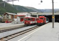 The modern Zermatt station is effectively a large avalanche shelter spanning all platforms. In this view station pilot MGB 72 is shunting Glacier Express stock with a push pull local train alongside. Zermatt is traffic free apart from small electric vehicles and receives all its supplies by rail. The wagons of the branch goods train are being unloaded in the sidings to the left of the picture.<br><br>[Mark Bartlett&nbsp;11/09/2013]