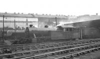 View south across a busy Heaton shed yard in the late 50s/early 60s towards Parsons engineering works. Locomotives in attendance include V3 67605 nearest the camera and V2 60806 standing in the left background.<br><br>[K A Gray&nbsp;//]