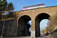 A 22 bus crossing the converted railway viaduct over Russell Road in November 2013. The former Caledonian route from Dalry Middle Junction to Haymarket West Junction closed in 1964.<br><br>[Bill Roberton&nbsp;16/11/2013]