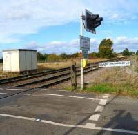 There is no�trace of the former station at Claxby & Usselby (closed in March 1960) which was located on the far side of the crossing on Park Road. View looking north on 9 October 2013.<br><br>[John McIntyre&nbsp;09/10/2013]