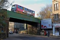 The rebuilt rail bridge over Dalry Road near the former Dalry Middle Junction. View west on 16 November 2013 with a no 22 bus crossing. [See image 29911]<br><br>[Bill Roberton&nbsp;16/11/2013]