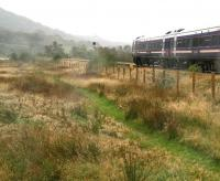 Nice day for a walk... at least it was when we set out! A fine misty rain arrives from the west near Strathcarron station on a Monday afternoon in late September 2009, just as the 11.01 ex-Inverness passes by on its way to Kyle of Lochalsh.<br><br>[John Furnevel&nbsp;28/09/2009]