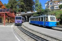 44 years separate these two rack railway units passing at Glion station. 1983 built 303 <I>Villeneuve</I> is descending from the Rochers de Naye summit to Montreux and has paused to connect with the Territet funicular. Immaculate single car 204, 74 years old, is on a short working to Caux.<br><br>[Mark Bartlett&nbsp;09/09/2013]