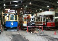 Vintage tram lineup in the depot at Beamish in November 2013. No 196 is originally from Portugal, built to a pre-First World War design and is now painted in Gateshead livery. Newcastle 114 was built in 1901 for the opening of Newcastle Corporation Tramway. Blackpool no 31 also dates from 1901 and was in service in Blackpool until 1984.<br><br>[John Furnevel&nbsp;07/11/2013]