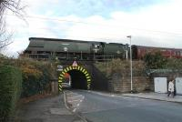 34067 <I>Tangmere</I> travels south along the WCML at Oxheys Loop on 21 November heading for Southall after overhaul at Carnforth. The Battle of Britain Pacific and support coach are crossing the very low Lytham Road bridge in Fulwood.<br><br>[Mark Bartlett&nbsp;21/11/2013]