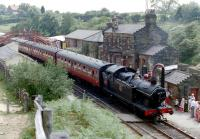 Departure from Goathland station on the North Yorkshire Moors Railway in July 1986. GWR 0-6-2T no 6619 is about to restart a train heading for Grosmont.<br><br>[Colin Miller&nbsp;/07/1986]