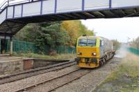 <I>Stand well back!</I> An MPV on leaf clearance duties slowly negotiates the sharp curve into Accrington station on 15 November with the water jets in full flow.<br><br>[Mark Bartlett&nbsp;15/11/2013]