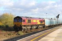 66194 creeps into the sidings at Didcot on 22 November with a lengthy freight.<br><br>[Peter Todd 22/11/2013]