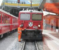 Manoeuvres at Chur, the junction where the eastbound <I>Glacier Express</I> is divided into two portions for Davos and St Moritz.  This was taken through the corridor connection of the Davos portion as it was shunted towards Rhaetian Ge 4/4 1 loco 605 <I>Silvretta</I>. This venerable machine, dating from 1953, is one of only four survivors of a class of 10 1588hp locos.  <br><br>[Mark Bartlett&nbsp;14/09/2013]
