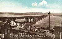 Wormit station at the south end of the Tay Bridge. This was the first station on the Newport Railway running east from here to Tayport. This postcard view shows the second bridge.<br><br>[Ewan Crawford Collection&nbsp;//]