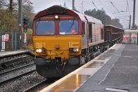 66041 passes through Kirknewton station with a Dalzell - Tees steel train on 26 November.<br><br>[Bill Roberton&nbsp;26/11/2013]