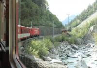 Climbing one of the Zermatt branch rack sections, where speed is limited to 25mph, is MGB No.4 <I>Taschhorn</I> on a train from Brig. The HGe 4/4 II 2590hp electric, dating from 1990, is one of a class of 21 that handle most MGB loco hauled services. <br><br>[Mark Bartlett&nbsp;11/09/2013]