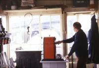 Signalman Mike Hayman at work in Cowley Bridge Junction signal box in June 1983 [see image 44796].<br><br>[Ian Dinmore&nbsp;/06/1963]