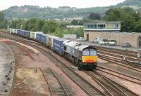 DRS 66408 crosses over to the Dundee line on the southern approach to Perth station in June 2006 with a train of containers from WHM Grangemouth destined for Aberdeen.<br><br>[John Furnevel&nbsp;15/06/2006]