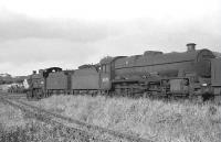 Steam locomotives stored in Lugton sidings on 26 June 1962 included Jubilee 45711 <I>Courageous</I> and class 2P 40621.<br><br>[John Robin&nbsp;26/06/1962]