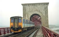 A Sprinter heads north to Kirkcaldy on the Forth Bridge in 1995. This photograph was taken during an inspection of the removal of bird lime. The track nearest the camera was closed at the time. If a train came we were asked to face the fence, place our arms over it and hold on. When a train finally came it was a tamper, going northbound at almost no speed, nonetheless we did as instructed.<br><br>[Ewan Crawford&nbsp;//1995]