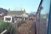 The closed station at Dalguise viewed from a northbound train on 8 February 1989. The train had just been flagged to safely cross the Dalguise Viaduct by the linesmen seen to the side of the locomotive. This was the day of the Ness Viaduct collapse.<br><br>[Ewan Crawford&nbsp;08/02/1989]