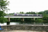 An afternoon Dundee - Glasgow Queen Street service crosses the Tay Viaduct at Perth in July 2006.<br><br>[John Furnevel&nbsp;15/07/2006]
