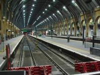 Platforms 1 to 4 at Kings Cross are unusually devoid of stock at 18.45 on 4 December, with only the lights of the Thunderbird class 67 stabled in the siding beyond the platforms visible.<br><br>[David Pesterfield&nbsp;04/12/2013]