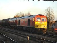 DB liveried 60040 pulls out of the down loop at the east end of Swindon Station on 4 December with the Theale to Robeston empty fuel tanks.<br><br>[David Pesterfield&nbsp;04/12/2013]