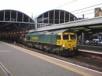 Freightliner 66554 runs northbound through Newcastle Central Station shortly after mid-day on 28 November with a rake of empty coal wagons.<br><br>[David Pesterfield&nbsp;28/11/2013]